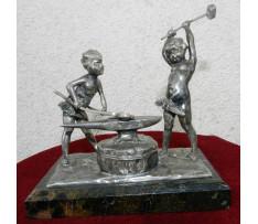 K.V.Mladý kováči koniec 19 stor. cín striebreny